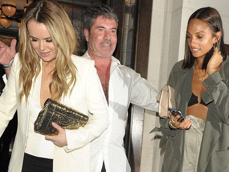 Simon Cowell looks a little worse for wear after partying in London