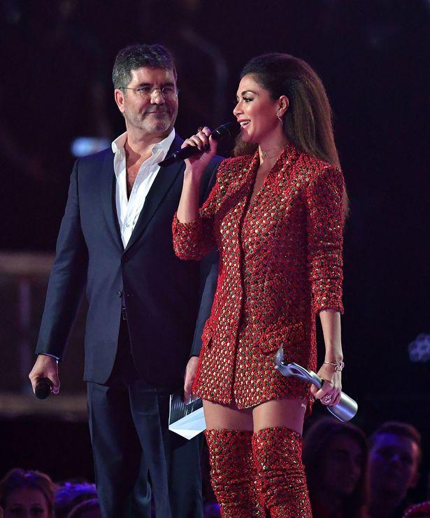 Simon Cowell with Nicole Scherzinger