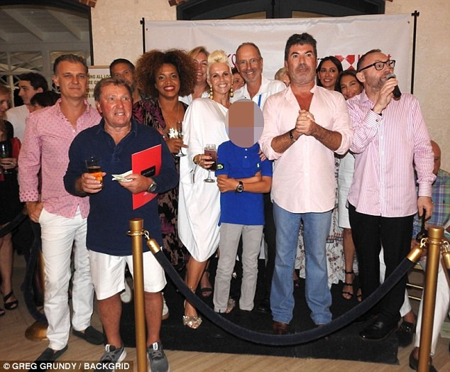 Simon Cowell and Lauren Silverman take their son Eric to the K9 friends charity in Barbados