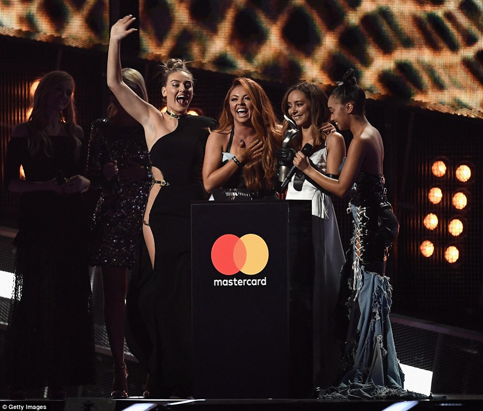 Little Mix accepting their award at the BRITs