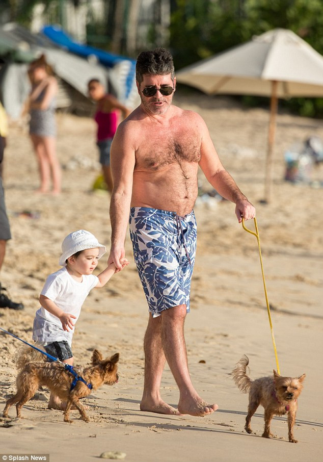 Simon Cowell with his son Eric in Barbados