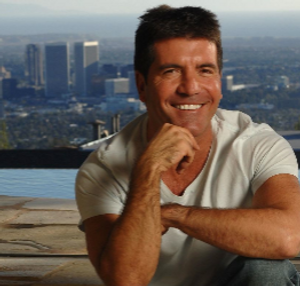 simon cowell sitting by his pool in Los Angeles