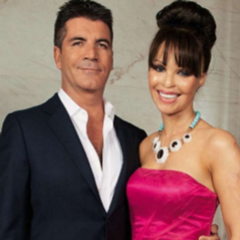 Simon Cowell with Katie Piper at a charity ball
