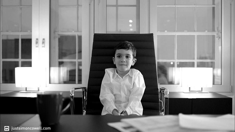 Simon Cowell's son Eric in Simon's office