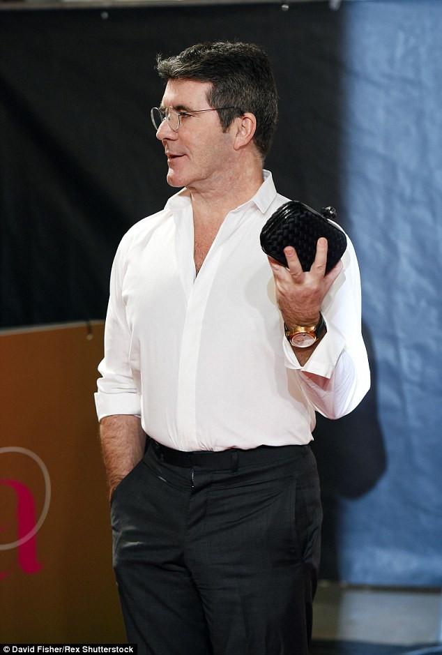 Simon Cowell left holding Lauren's bag at the ITV Gala