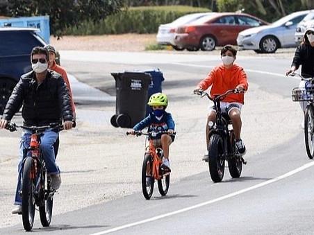 Simon Cowell takes his family for a bike ride in Malibu
