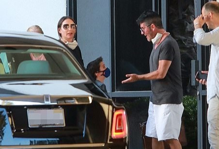 Simon Cowell arrives back in Los Angeles after a family break
