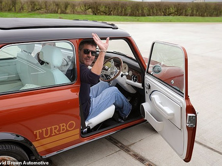For Your Eyes Only - Simon Cowell takes delivery of a very special Mini