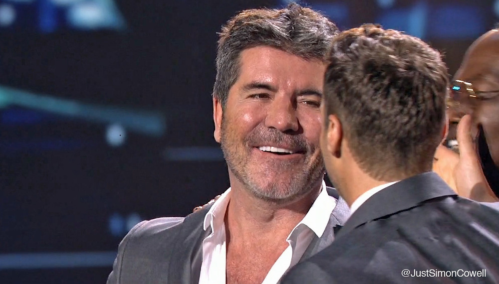 Simon Cowell with Ryan Seacrest on the American Idol final