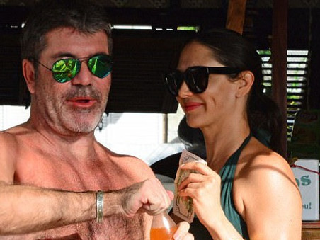 Simon Cowell and Lauren Silverman cool off with a drink at the bar in Barbados