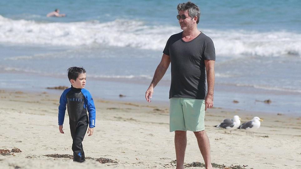 Simon Cowell takes his son Eric surfing in Malibu