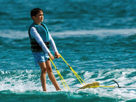 Simon Cowell watches over Eric as he tries water skiing for the first time.