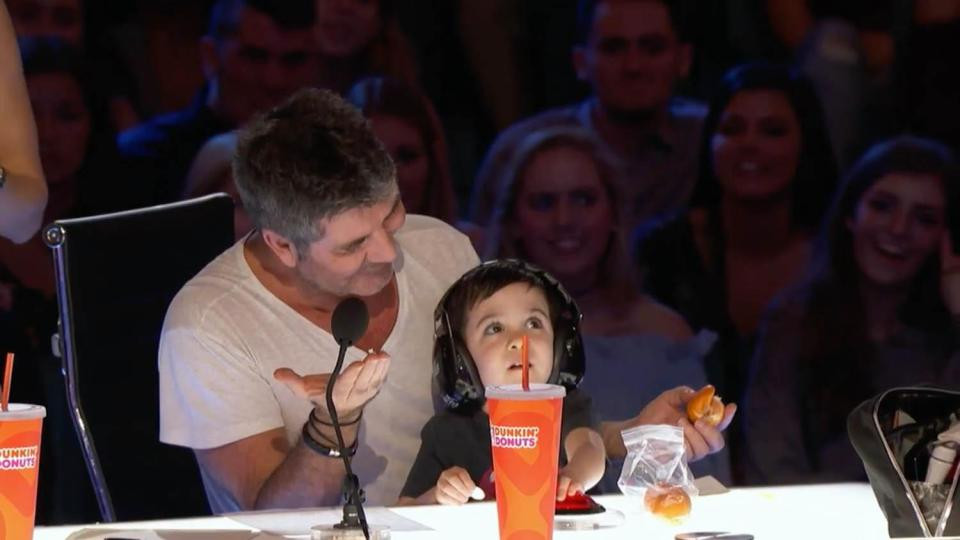 Simon Cowell with his son Eric on America's Got Talent