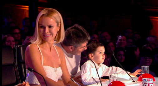 Simon Cowell with his son Eric on Britain's Got Talent