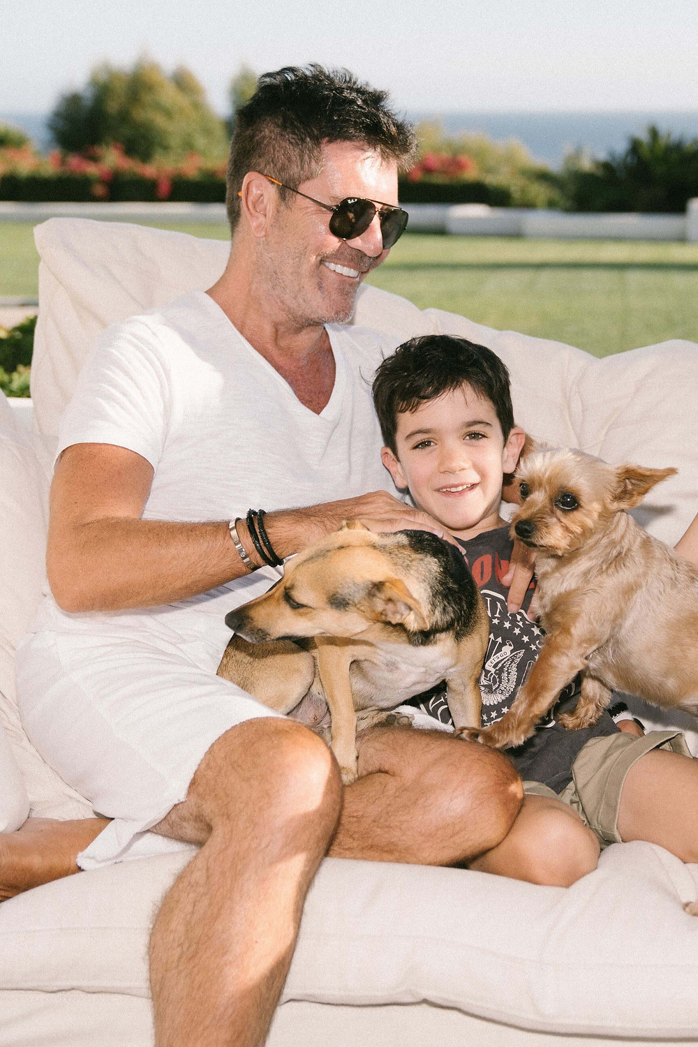Simon Cowell and Eric with two of their dogs