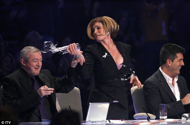 Sharon Osbourne throws a glass of water over Louis Walsh on X Factor