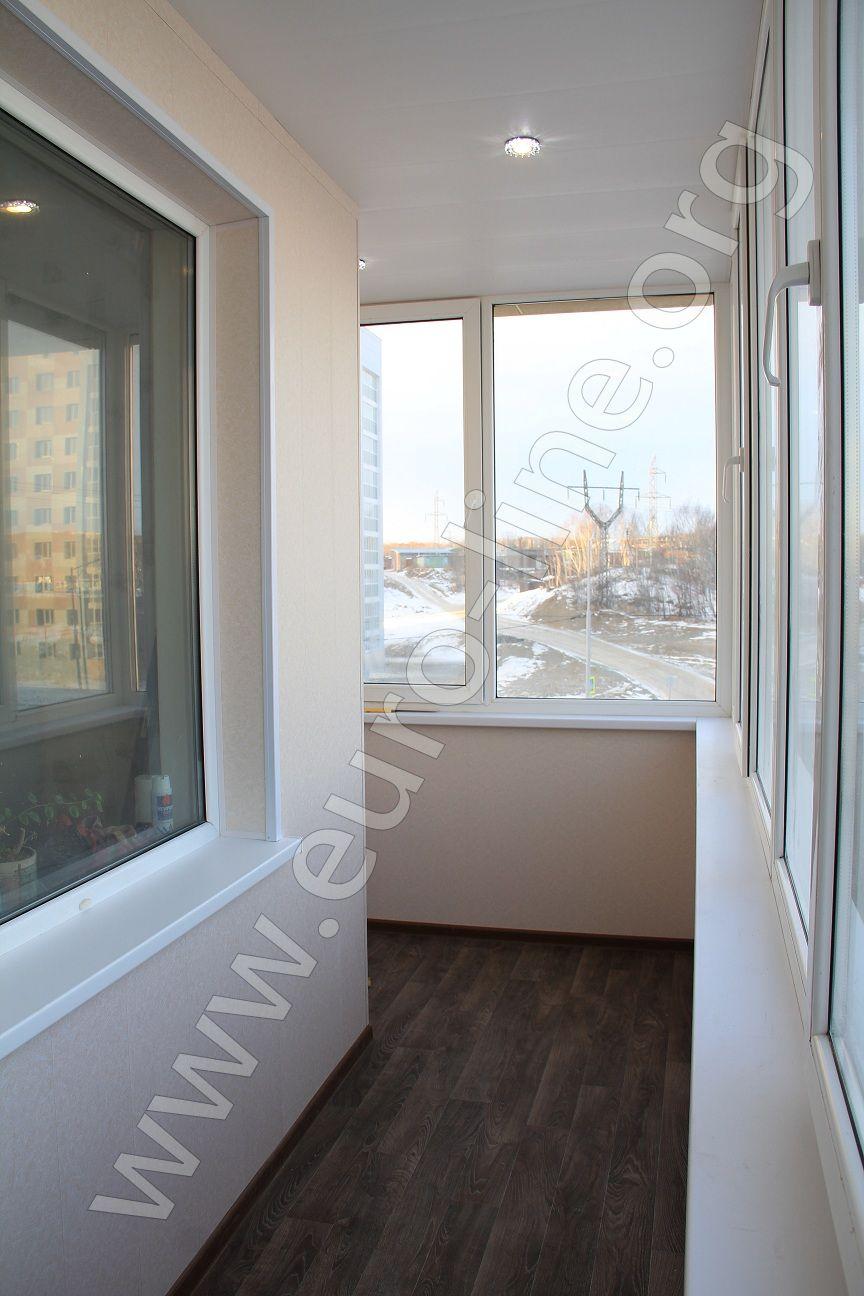 Отделка углового балкона