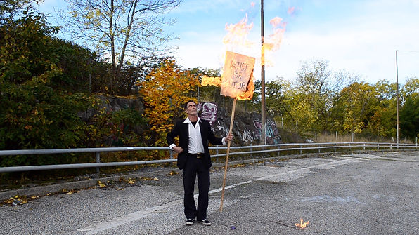 Activist with burning sign