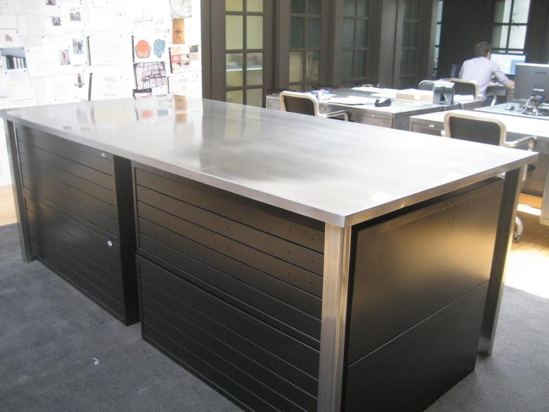 93. Modern polished steel table