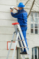 Mature Male Technician Standing On Stepl