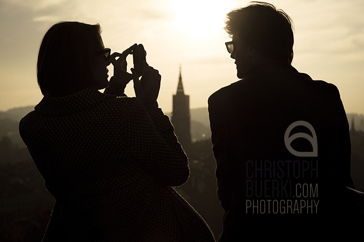 woman and man photographing