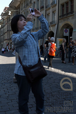 tourist in front of the zytglogge