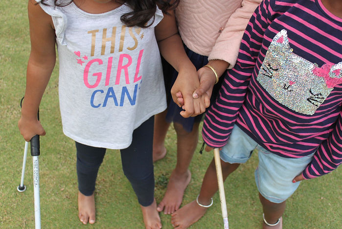 three girls hold guide canes