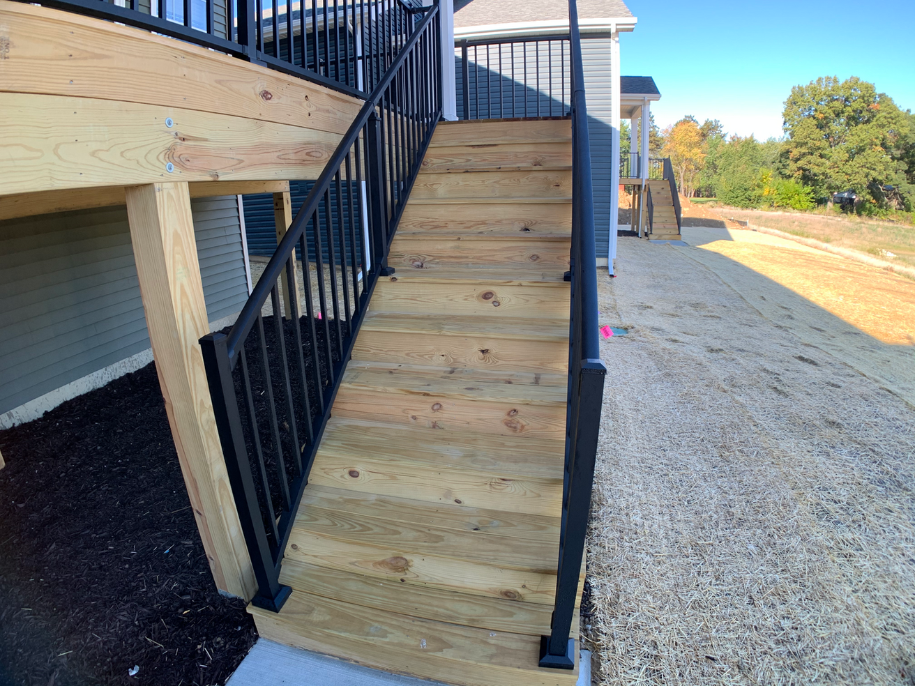 Juniper Covered Porch Stairs.png