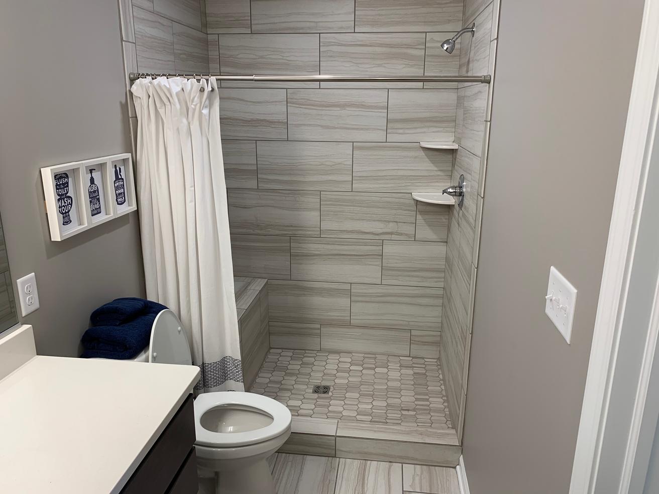 Magnolia Master Bathroom 3.png