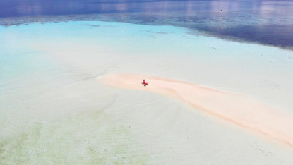 Drone photo of the sand bank in front of Yenbuba Homestay