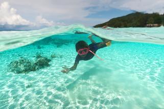 Naomi Sauyai swimming in front of Yenbuba Homestay
