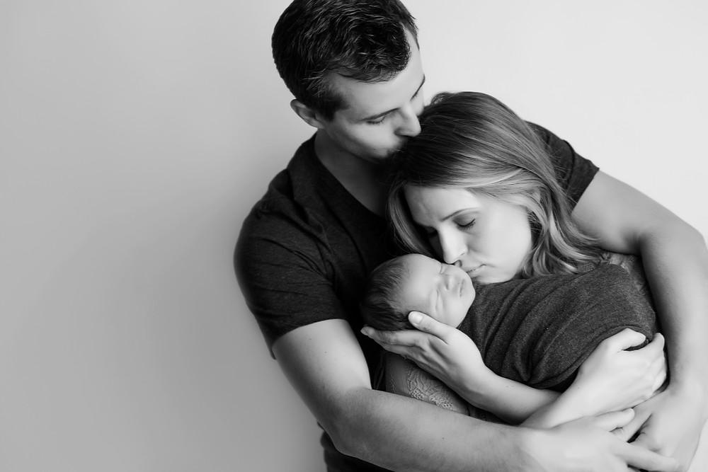 Mom & Dad kissing newborn, BennyAni Twin Cities Photography