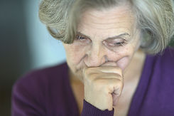 Beautiful sad elderly woman close-up.jpg