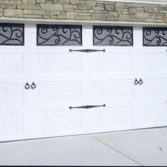 White Carriage House Door with wrought iron look windows.