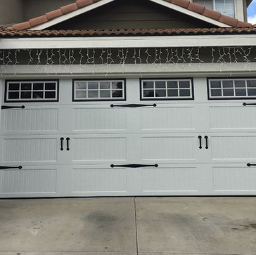 White Carriage House Door with windows and decorative hardware  $1,300