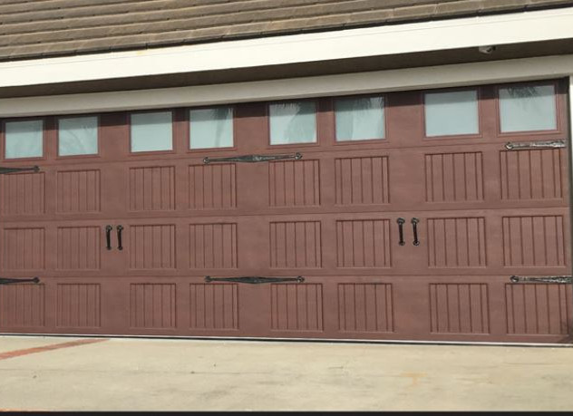 Wood like color and grain Carriage House Door with windows and decorative hardware $1,550
