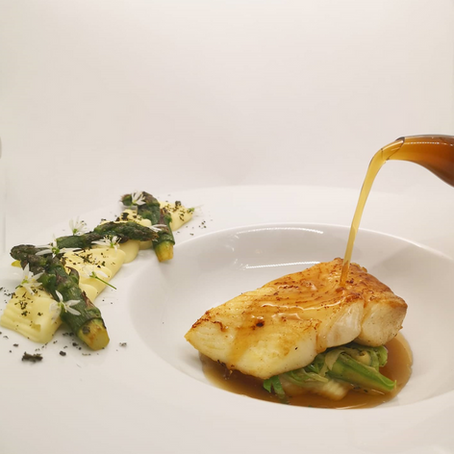 Baked Line Caught Halibut, Pomme Puree, Sauteed Spring Greens, Nettle Consommé & Nettle Powder.