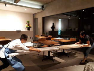 """later on that night, preparing to hang some of the artworks on the wall. Getting the """"Life Force : Terrain No. 12"""" out of its box, with Engel's help. . the setting up of """"Life Force : a solo exhibition"""" . photo by Indriaty"""
