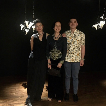 with Ms. Tjhie Zien Ing (mother) and Mr. Lie Heng (brother)
