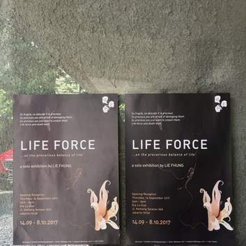 The poster of Life Force Solo Exhibition near the entrance to Dia.lo.gue