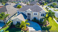 aerial drone shot looking down at a big two story house