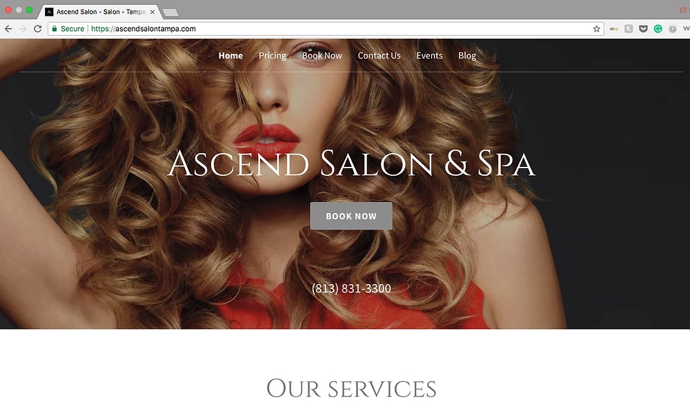 woman with red lips screenshot on a mac computer of a hair salon in tampa florida as their main front website page.