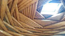 Traditional interior of Diné ceremonial Hogan representing the beauty way of K'é.