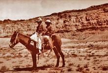 Dine' boys herding sheep near Mexican Water, AZ in 1946.
