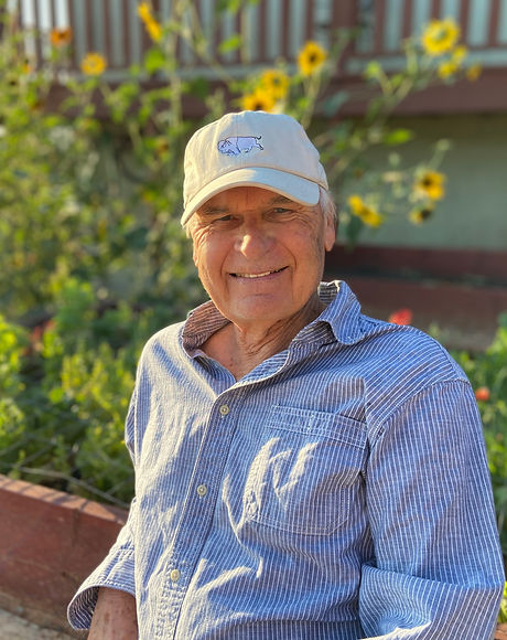 Smiling man near flower