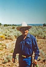 Irvin Curley in their cornfield on home site near Ganado, AZ in 1994.