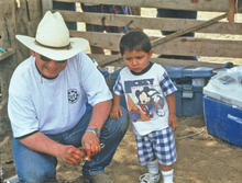 Doc McNeal with young Dine' boy wanting to learn, after working lambs in1997.