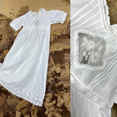 Antique christening gown made of fine cotton. Film prop. Styling.