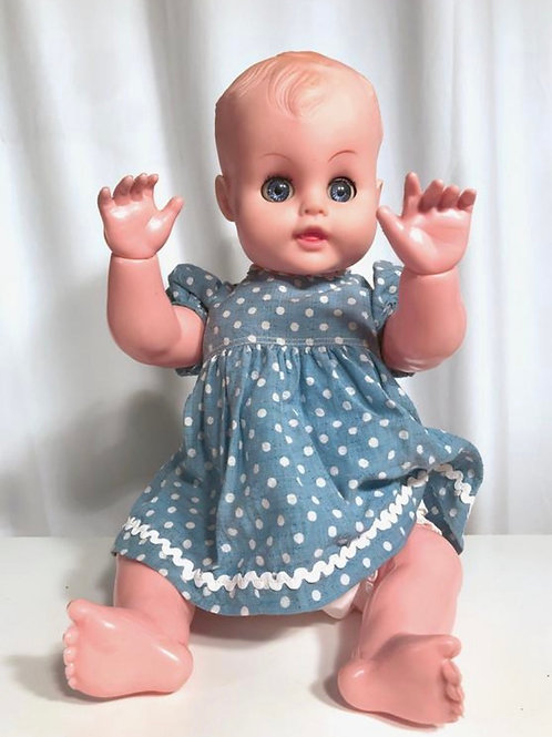 Vintage baby doll. Evergreen doll collectors baby girl in polka dot dress.