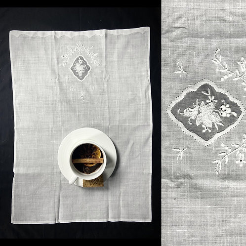 Broderie anglaise white linen serviettes with a floral detail